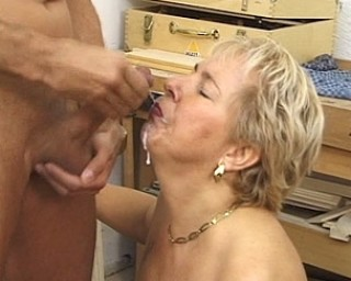 Horny cougar fucking in a workshop