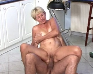 Naughty housewife doing it in the kitchen